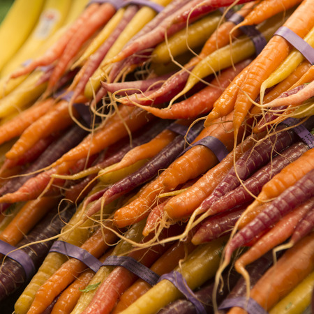 pike place: Stack of carrots for sale at a market stall, Pike Place Market, Seattle, Washington State, USA Stock Photo