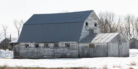 old barn in winter: Barn in snow covered field, Hecla Grindstone Provincial Park, Manitoba, Canada