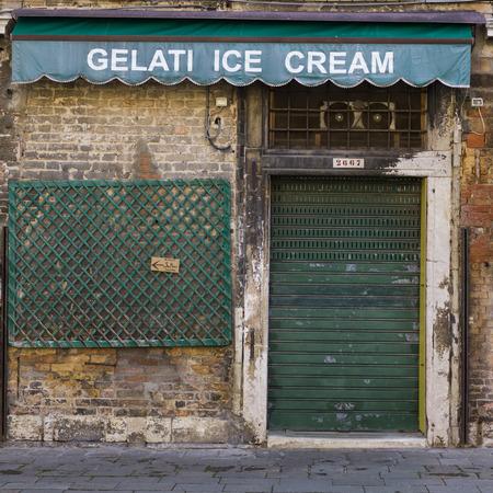 entranceway: Closed shutter of shop doorway, Venice, Veneto, Italy