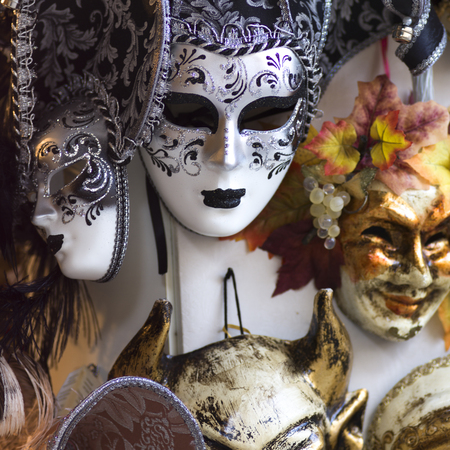 Decorative masks hanging in store, Venice, Veneto, Italy Imagens