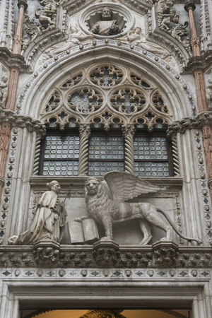 likeness: Statue of Winged Lion of St Marks and Doge adorns building, Doges Palace, Venice, Veneto, Italy