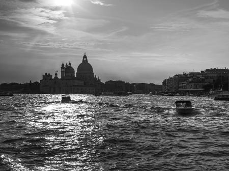 Boats in Grand Canal with Santa Maria Della Salute in the background, Venice, Veneto, Italy