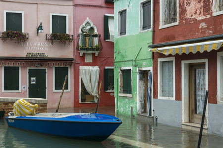 entranceway: Boat moored in canal by houses, Burano, Venice, Veneto, Italy