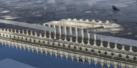 vecchie: Procuratie Vecchie reflecting in puddle, St Marks Square, Venice, Veneto, Italy