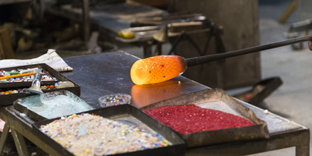 Close-up of glass being molded in factory, Murano, Venice, Veneto, Italy Stock Photo