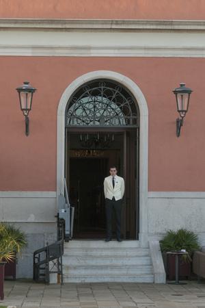 entranceway: Man standing in doorway, Cannaregio, Venice, Veneto, Italy Editorial
