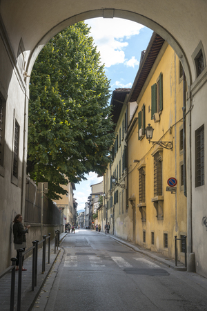 incidental people: Buildings along street, Florence, Tuscany, Italy