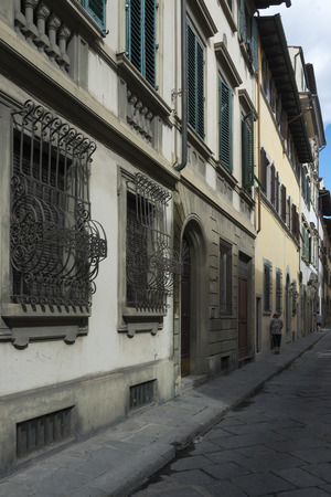 security shutters: Buildings along street, Florence, Tuscany, Italy