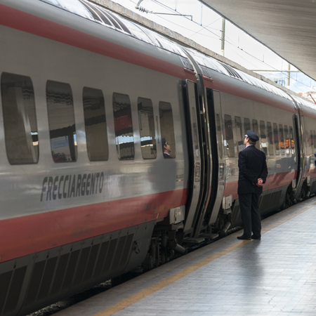 guard rail: Train conductor standing on platform by train, Florence, Tuscany, Italy Editorial