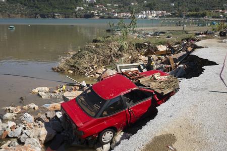 Car destroyed by storm at riverside, Thessalia Sterea Ellada, Skopelos, Greece