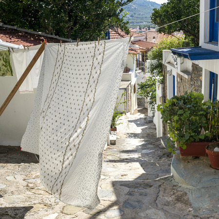 residential structure: Clothes drying on clothesline, Thessalia Sterea Ellada, Skopelos, Greece Stock Photo