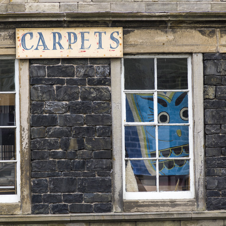 scottish culture: Sign on wall by window, Castle Street, Banff, Aberdeenshire, Scotland