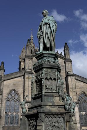 scottish parliament: Statue of Walter Montagu Douglas Scott at Parliament Square, Edinburgh, Scotland Stock Photo