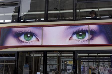 Poster of eyes on tour bus, Edinburgh, Scotland