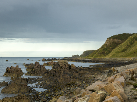 physical geography: Scenic view of rocky coast against cloudy sky, Cullen, Moray, Scottish Highlands, Scotland Stock Photo