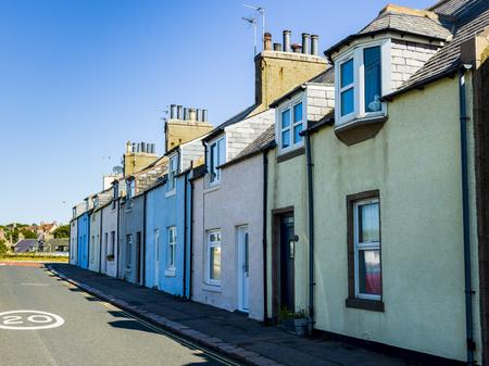 View of houses along street, Cruden Bay, Aberdeenshire, Scotland