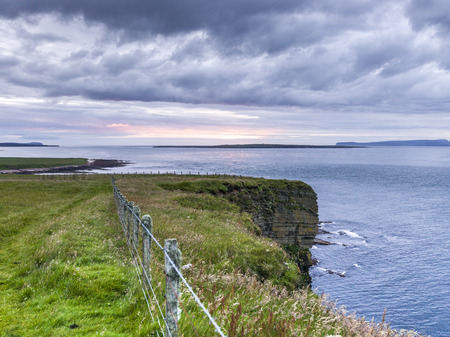 fencepost: Scenic view of fence at coast against cloudy sky, John O Groats, Caithness, Scottish Highlands, Scotland