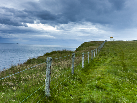 Scenic view of fence at coast against cloudy sky, Duncansby Head Lighthouse, John o Groats, Caithness, Scottish Highlands, Scotland