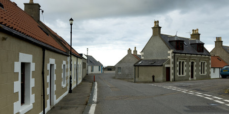 View of houses along street, Cullen, Moray, Scotland