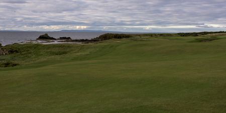 golfcourse: Golf course at coast against cloudy sky, Scottish Highlands, Scotland