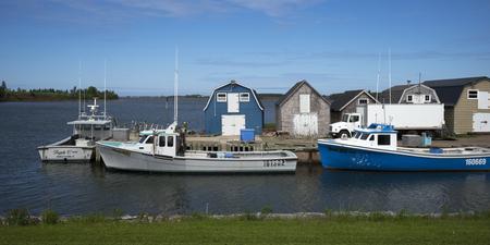 Fishing sheds and boats at dock, Green Gables, Prince Edward Island, Canada Editorial