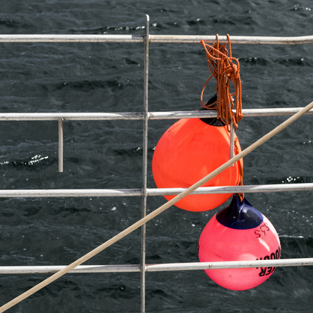 buoys: Buoys hanging on railing in harbor, West Dover, Halifax, Nova Scotia, Canada Stock Photo