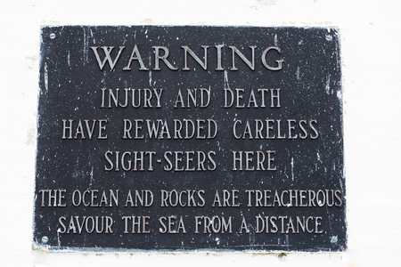 Warning sign at Peggys Point Lighthouse, Peggys Cove, Nova Scotia, Canada