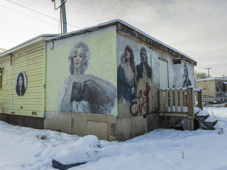 female likeness: Murals on wall of a building in snow, Chetwynd, British Columbia, Canada Editorial