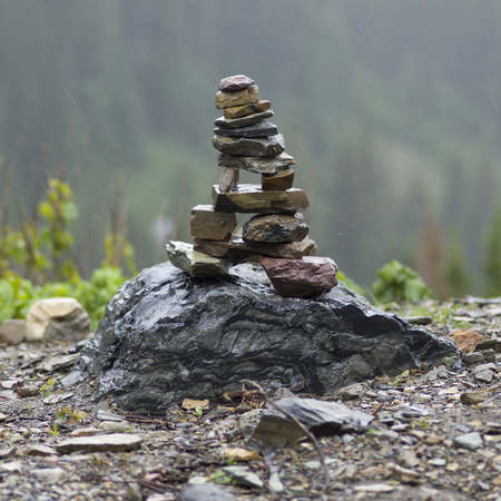 Close-up of stack of stones on rock, Going-to-the-Sun Road, Browning, Glacier National Park, Glacier County, Montana, USA