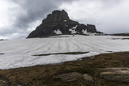 Snow on landscape with mountain in the background, Logan Pass, Glacier National Park, Glacier County, Montana, USA Stock Photo