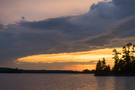 Clouds over the lake at sunset, Lake of The Woods, Ontario, Canada Stock Photo