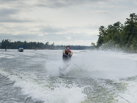 lake front: Man waterskiing in the lake, Lake of The Woods, Ontario, Canada