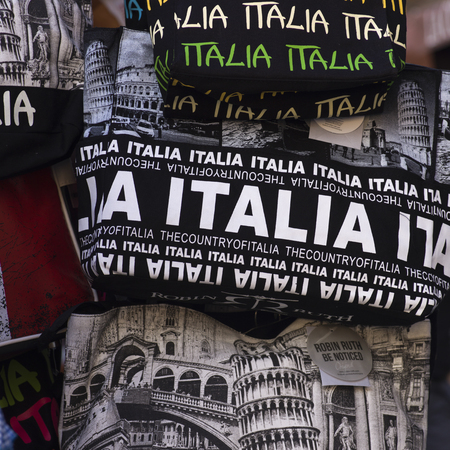 T-shirts on sale at market stall, Siena, Tuscany, Italy
