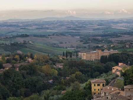 destination scenics: Elevated view of buildings with rural landscape in background, Siena, Tuscany, Italy