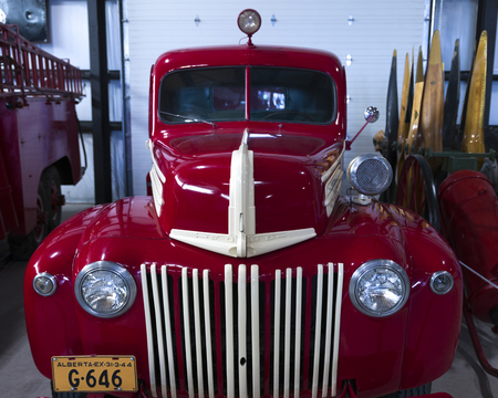 antique fire truck: Ford fire engine at Bomber Command Museum of Canada, Nanton, Southern Alberta, Alberta, Canada