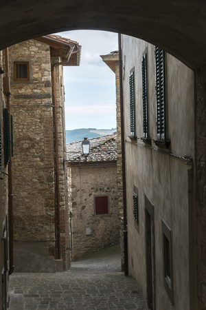 Narrow alley by houses in town, Radda in Chianti, Tuscany, Italy Stock Photo