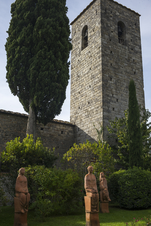 shrubbery: Statues in front of church bell tower, Gaiole in Chianti, Tuscany, Italy Stock Photo