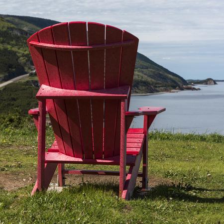 Adirondack chair at coast, Petit Etang, Cape Breton Highlands National Park, Cape Breton Island, Nova Scotia, Canada Stock Photo