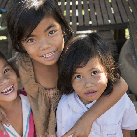Portrait of happy children looking at camera, Siem Reap, Cambodia