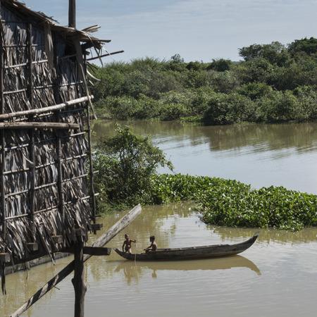 riverbank: Elevated view of children rowing boat in Tonle Sap Lake, Kampong Phluk, Siem Reap, Cambodia