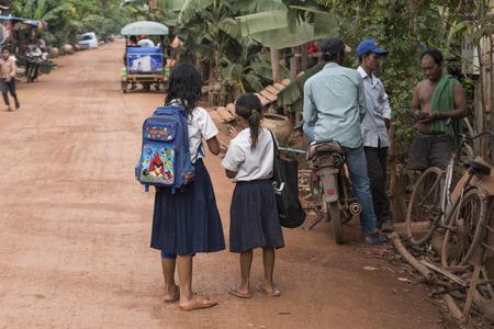 People standing on street in village, Siem Reap, Cambodia
