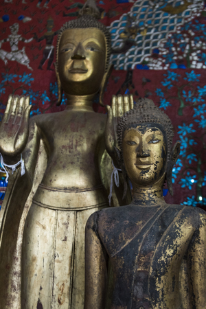 Statues in temple, Wat Xieng Thong temple, Luang Prabang, Laos Editorial