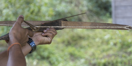 Person hand aiming with crossbow, Luang Prabang, Laos Stok Fotoğraf - 87903969