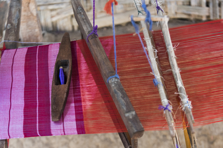 Close-up of fabric weaving on loom, Laos Stock Photo