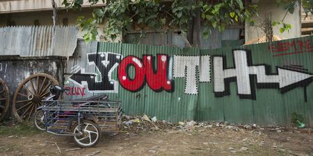 Graffiti on iron wall, Krong Siem Reap, Siem Reap, Cambodia