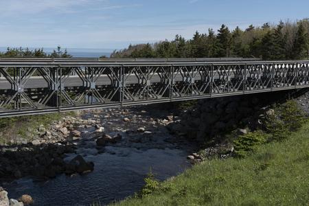 Bridge across river in forest, Pleasant Bay, Cape Breton Highlands National Park, Cape Breton Island, Nova Scotia, Canada