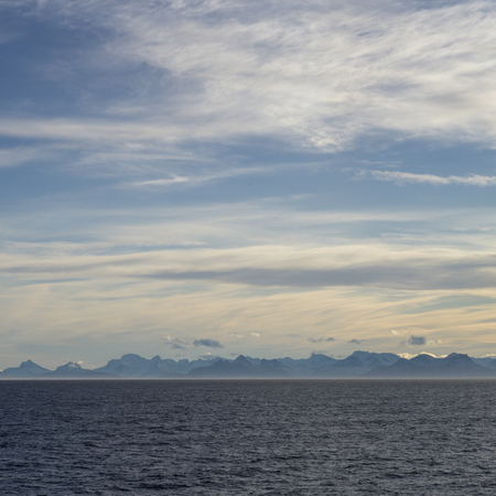 Sea with mountain range in the background, Norway Stock Photo