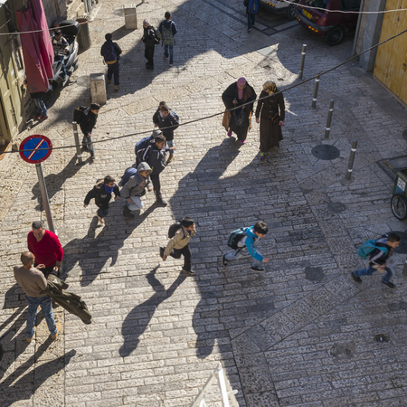 High angle view of school children running on street, Jerusalem, Israel