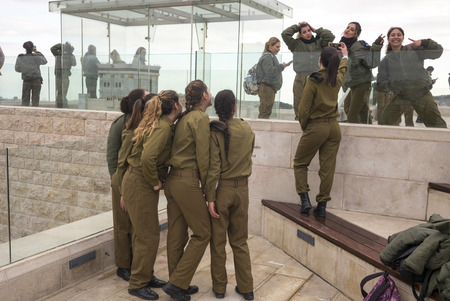 Group of female army soldiers of Israel Defense Forces having fun at leisure, Old City, Jerusalem, Israel