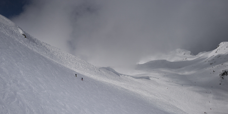 Skiers on snowy mountain, Whistler, British Columbia, Canada